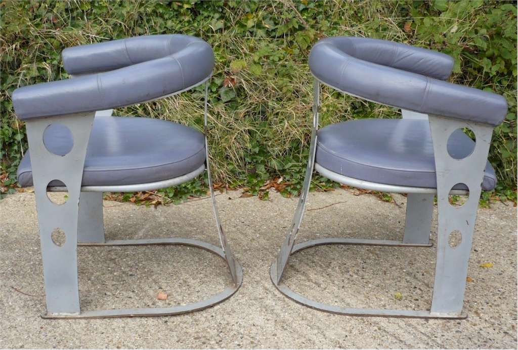 Pair of upholstered steel armchairs