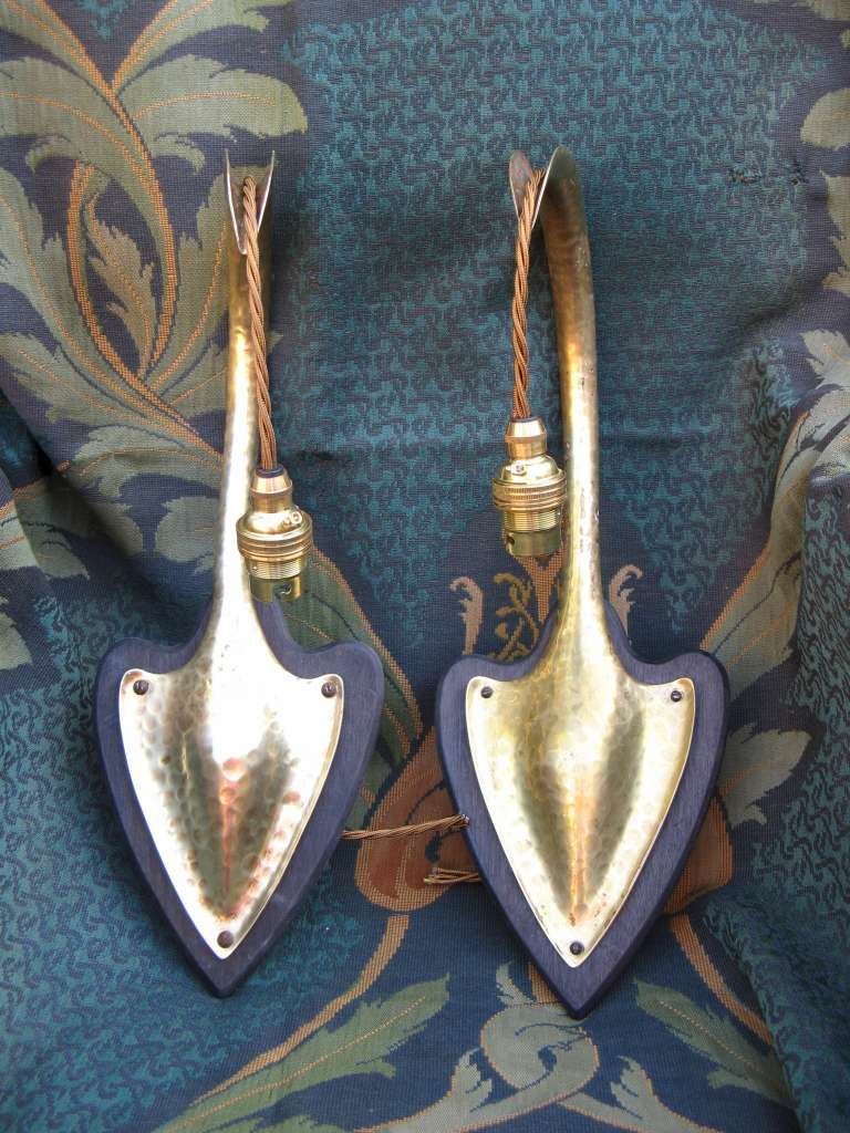 Pair of arts and crafts wall lights in hammered brass on wooden pair of arts and crafts wall lights in hammered brass on wooden heart shaped backplates aloadofball Choice Image