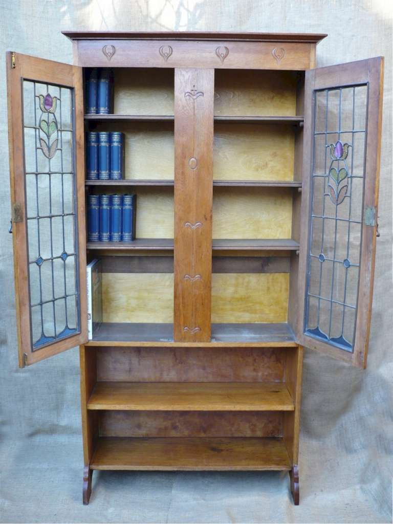 Arts and crafts bookcase with stained glass doors