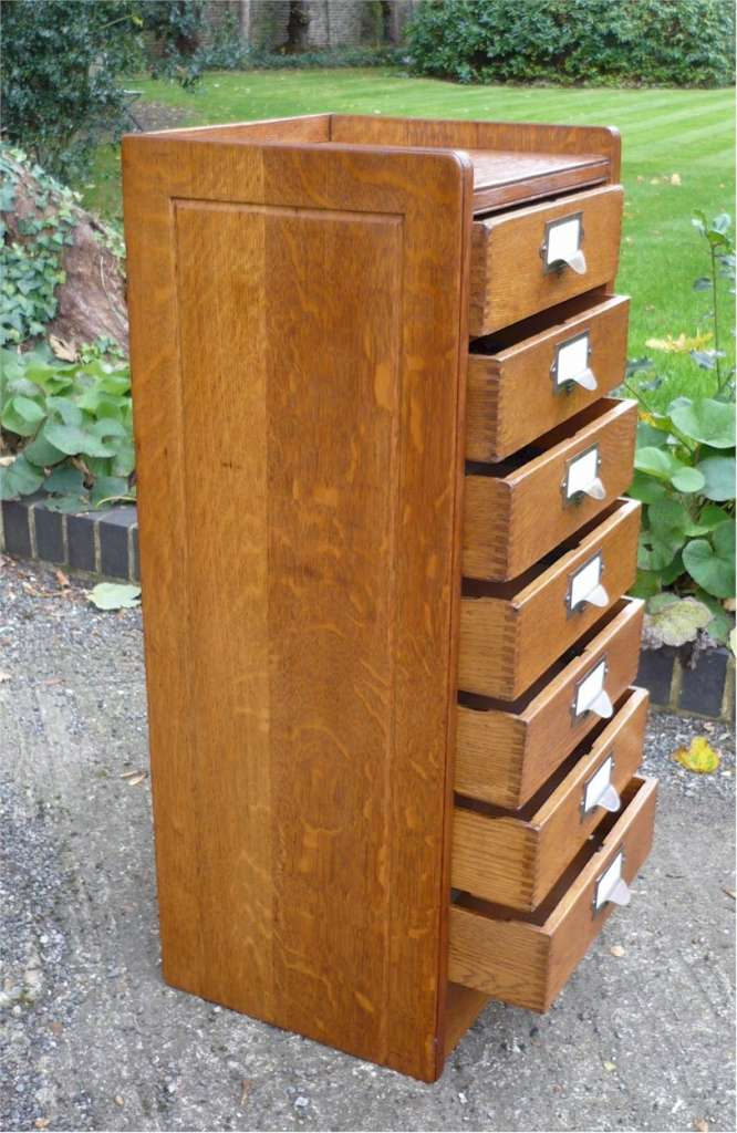 Globe filing cabinet in golden oak