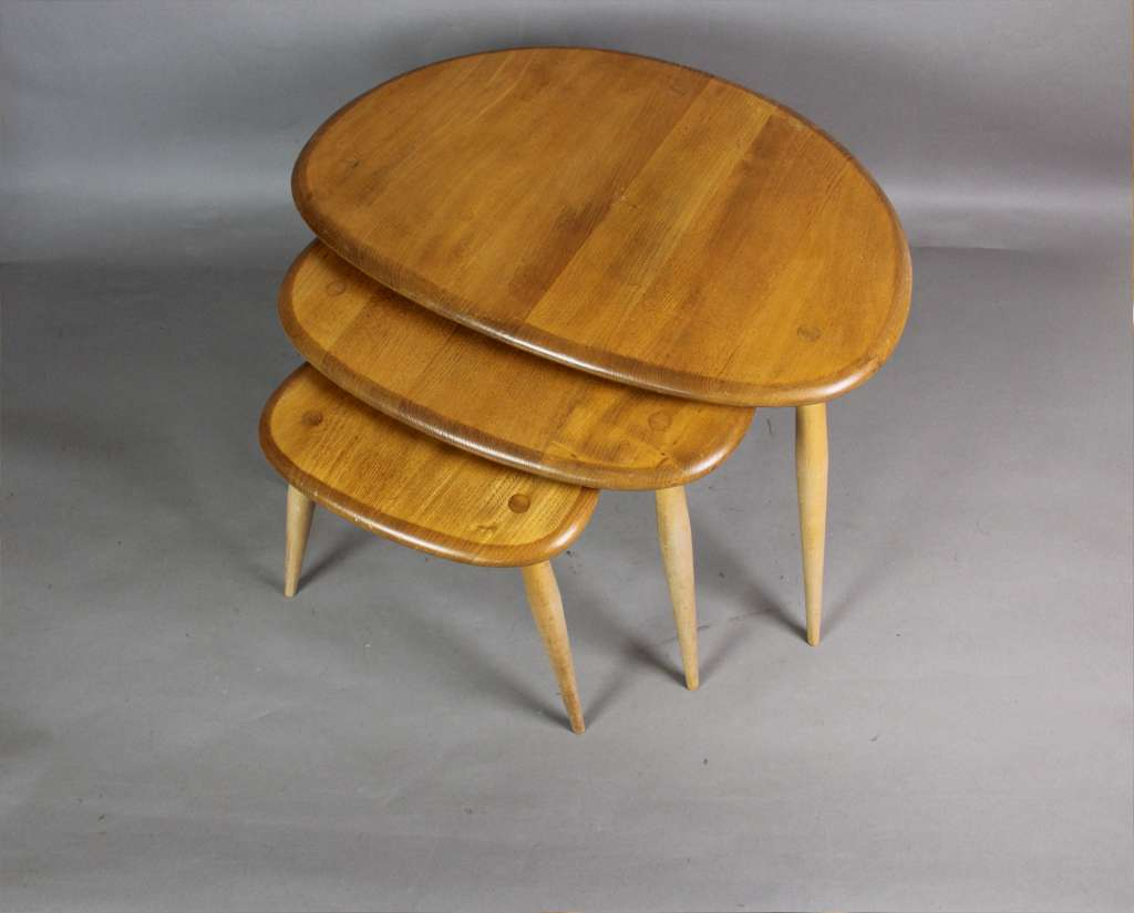 Ercol pebble nest of three tables in light coloured Elm. Ercol pebble nest of three tables in light coloured Elm