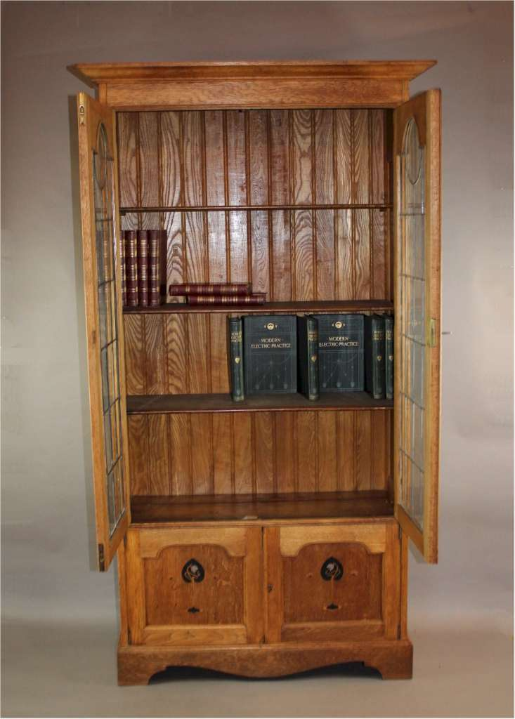 Arts and crafts oak glazed bookcase with pewter and ebony for Arts and crafts bookshelf
