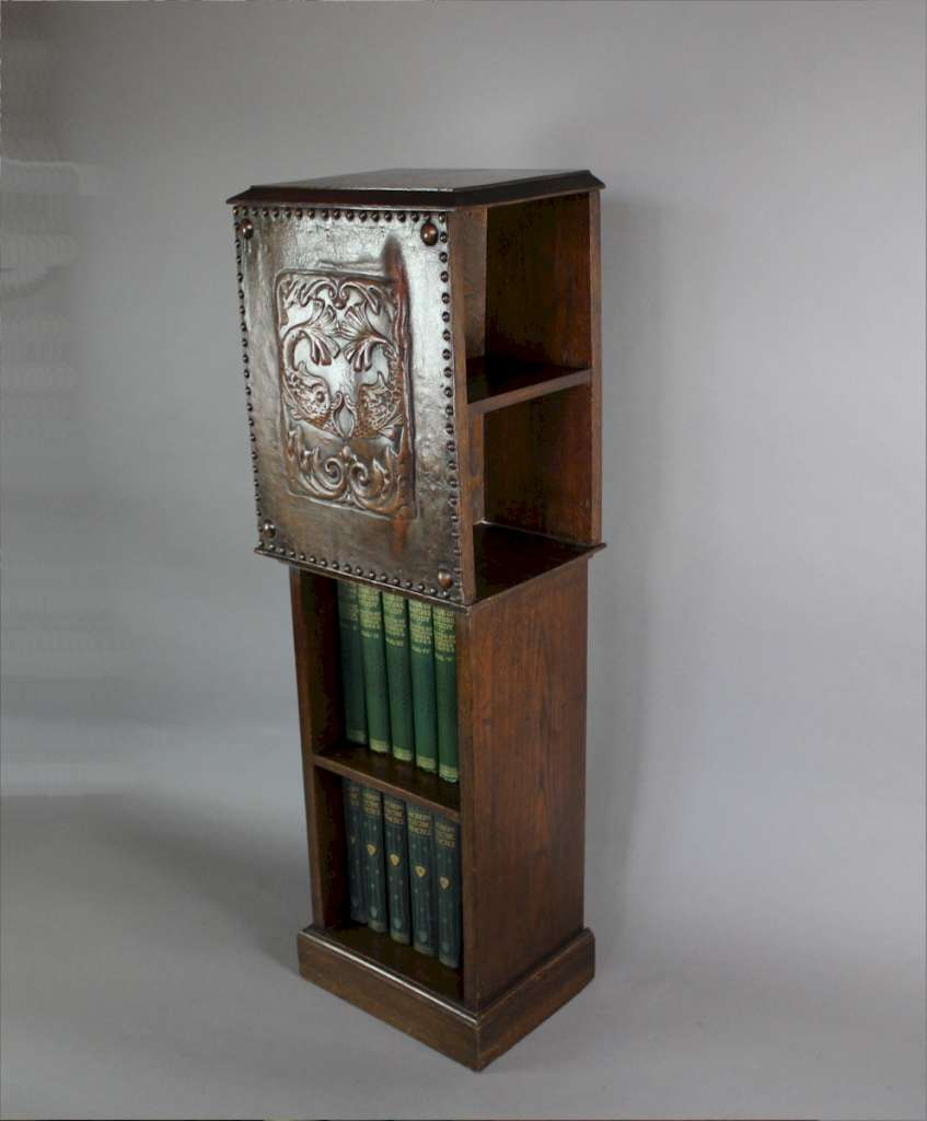 Arts and crafts pedestal bookcase with leather serpent for Arts and crafts bookcase