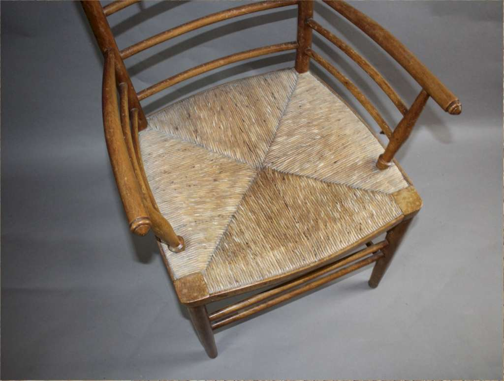 arts and crafts sussex armchair in beech with rush seat. Black Bedroom Furniture Sets. Home Design Ideas