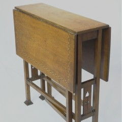 Arts and crafts inlaid drop leaf side table in oak