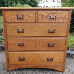 Large, stylised ,arts and crafts chest in golden oak
