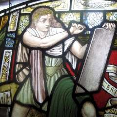 Victorian pre-raphaelite stained glass of a scribe