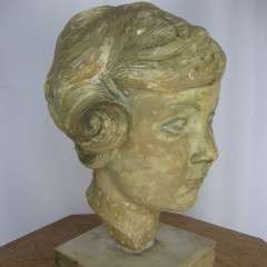 Plaster bust of a young girl by Mario Bernasconi 1899-1963