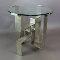 Italian 1970's circular glass topped table on silvered stepped iron base