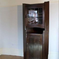 Arts and Crafts oak tall corner display cabinet by Liberty & Co circa 1900