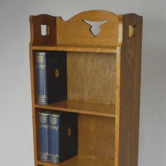 Narrow arts and crafts bookcase in golden oak