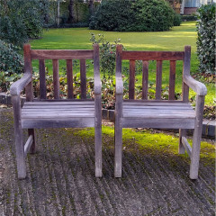 Pair of heavy , teak garden chairs , doweled joints