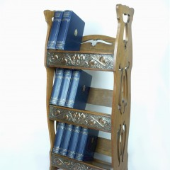 Arts and crafts bookcase with repoussee decoration