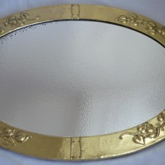 Large arts and crafts mirror in brass