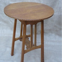 Arts and crafts circular inlaid lamp table in oak