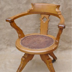 Gothic revival swivel desk chair in pale oak