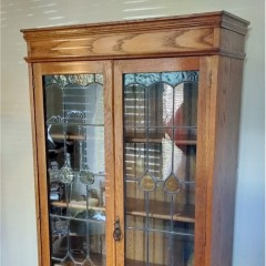 Arts and crafts bookcase , coloured leaded glass