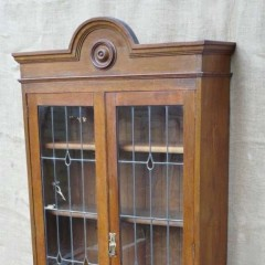 Arts and crafts bookcase in oak with yellow glass