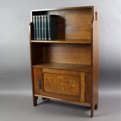 Shapland and Petter arts and crafts dwarf bookcase in oak with chequered and coloured inlay