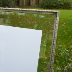 Large , art deco picture frame with beveled glass