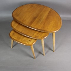Ercol pebble nest of three tables in light coloured Elm