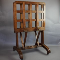 Victorian oak Folio stand on brass castors