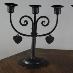 Pair of arts and crafts candlesticks by Goberg