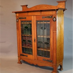 Arts and Crafts oak inlaid and glazed bookcase