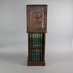 Arts and Crafts pedestal bookcase with leather serpent panel c1900
