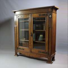 Pewter and ebony inlaid arts and crafts bookcase
