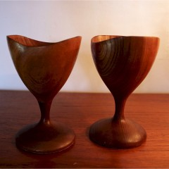 Pair of mid century teak candlesticks